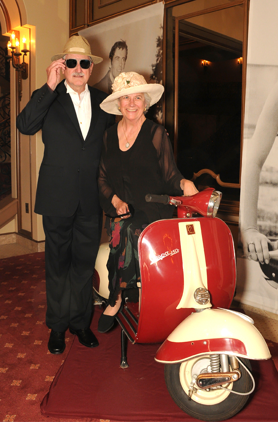 Duncan and Suzanne Mellichamp pose with a Vespa at a ''La Dolce Vita'' opera fundraiser. Photo courtesy of Opera Santa Barbara