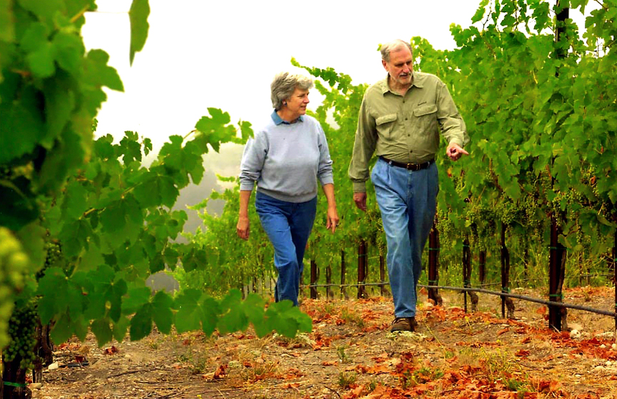 Suzanne and Duncan Mellichamp stroll the vineyard they co-owned in the 1990s.