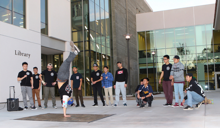 Guests at the library's Open House were treated to 'UCSBreakin',' a break-dancing performance, in the Courtyard. Credit: Monie Photography