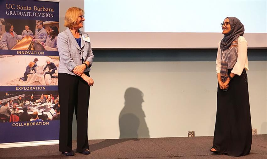 Carol Genetti questions competitor Gokh Amin after her talk. Credit: Patricia Marroquin