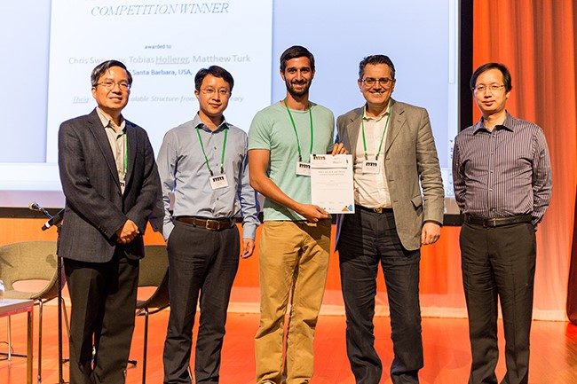 Chris, center, accepting the top prize for Open-Source Software at the 2015 ACM Multimedia Conference in Brisbane, Australia. Photo courtesy of Chris Sweeney